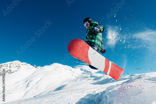 Obrazy Snowboard  snowboarder-is-jumping-with-snowboard-from-snowhill