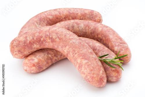 Fotografia Raw sausage with parsley leaf isolated on white background.
