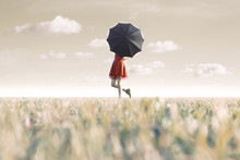 Woman Hides Behind His Black Umbrella In A Surreal Place