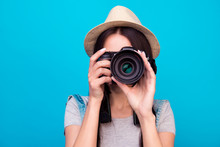 Close Up Photo Of Woman In Hat On Blue Background Taking A Photo With Digital Camera
