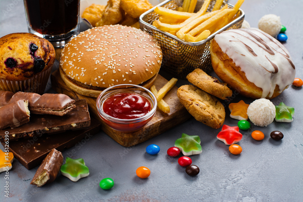 Fototapety, obrazy: Assortment of unhealthy products that's bad for figure, skin, heart and teeth. Fast carbohydrates food. Space for text