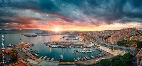Fotografie, Obraz Cagliari, Italy 20/04/2017; Panoramic view of Cagliari at sunset on the harbor