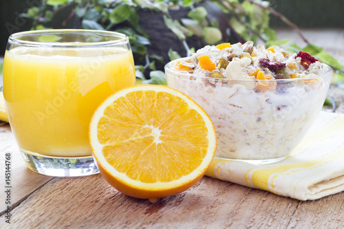 An ideal healthy breakfast  Oatmeal with nuts and dried