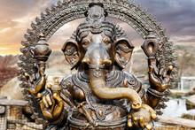 Statue Of Hindu Elephant God Ganesha Outdoors Against Dramatic Sky