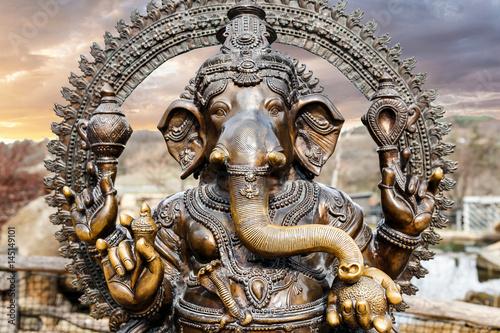 Canvastavla  Statue of Hindu Elephant God Ganesha outdoors against dramatic sky