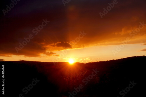 Poster Volcano sunset landscape small mountain with clouds in the sky red