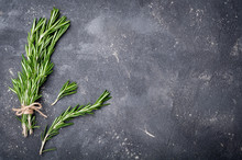 Rosemary On Dark Background. Herbs And Spices. Top View And Copy Space For Your Recipe