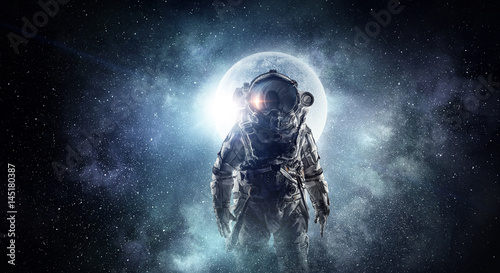 Astronaut in outer space. Mixed media . Mixed media Wallpaper Mural