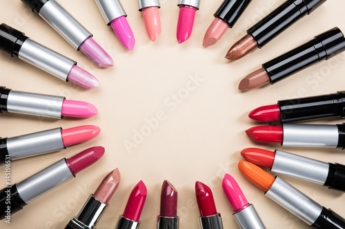 Various Colorful Lipstick Arranged In A Circle Poster