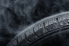 Car Tire Covered With Water Dr...