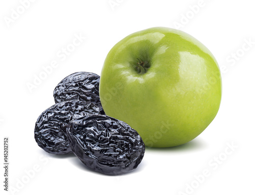 Stampe  Whole green apple back and dry plums isolated