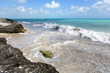 Sea shore. The coastline of the Caribbean sea. Cloudy sky on a partly sunny day.