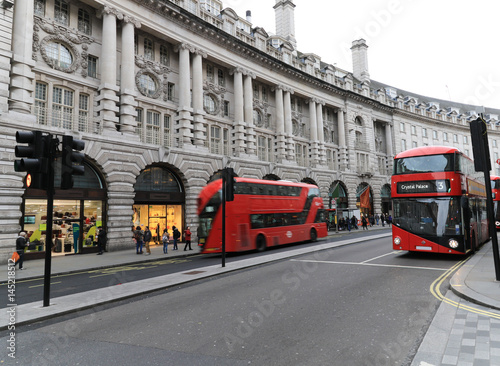 Foto op Canvas Londen rode bus Busses drive up and down London's Regent Street