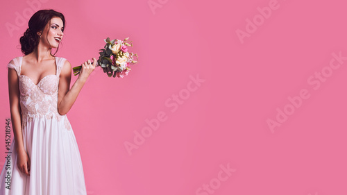 Brunet bride portrait in pink studio - 145218946