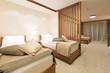 Hotel apartment, bedroom interior in the evening