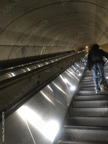 very long escalator in metro subway system Plakát