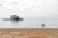 Day View Of Two Women Over Brighton Pier After Fire