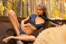 Beautiful Blonde Model Poses With An Old Truck Mechanism