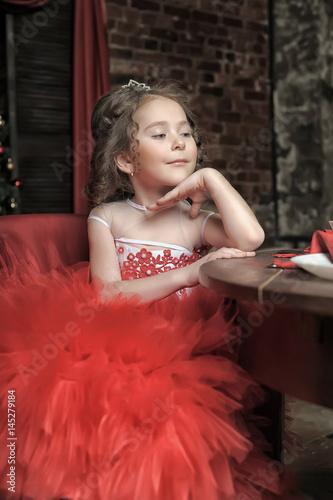 Vászonkép Little girl in red princess dress