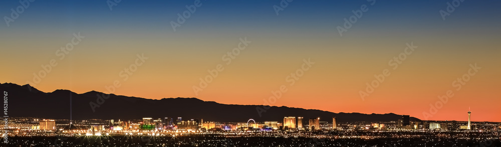 Fototapeta Colorful sunset over Las Vegas, NV cityscape with city lights