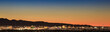 canvas print picture - Colorful sunset over Las Vegas, NV cityscape with city lights