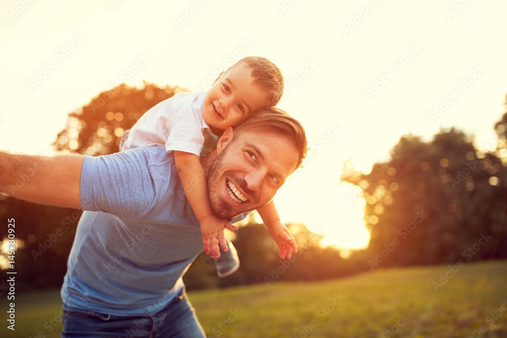 Fototapety, obrazy: Father piggyback his son outside