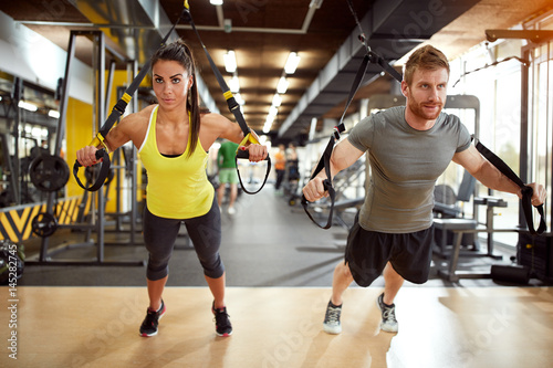 Foto op Plexiglas Fitness Couple on body training in gym
