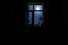 Night Scene Of Moon Seen Through The Window From Dark Room