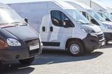 Fototapeta Miasto - minibuses and vans outside