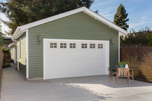 Side View Of House Exteriors And Garage Entrance