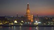 Wat Arun at twilight time. Buddhist temple located along the Chao Phraya river in Bangkok, Thailand 4k