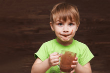 The Kid Drinks Cocoa At Home.