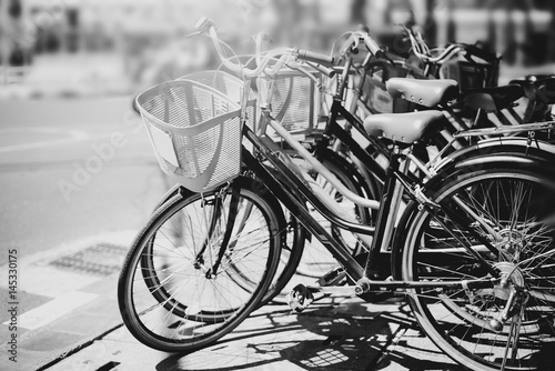 Papiers peints Velo black and white travel bicycle for rent in urban. vintage color effect