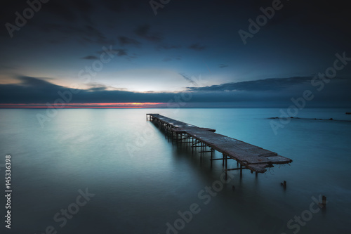 Old broken bridge in the sea, long exposure Fotobehang