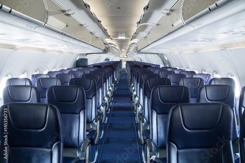 Tuinposter Sitzreihen im Flugzeug