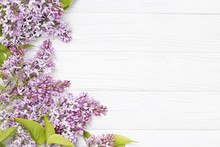 Lilac Flowers On The White Woo...