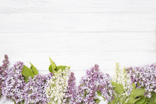 Lilac Flowers On The White Wooden Background.