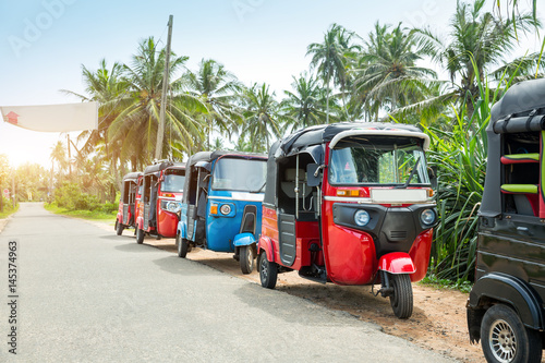 Tuktuk taxi on road of Sri Lanka Ceylon travel car Wallpaper Mural