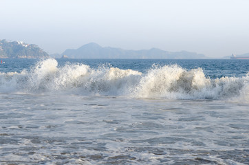 Breaking tidal waves at Mirimar Beach in Manzanillo, Colima, Mexico in the Caribbean
