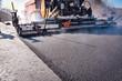 canvas print picture - Strassenbau - Teermaschine macht neue Asphaltdecke