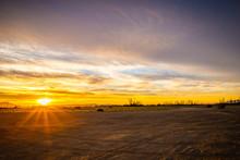 Desert Sunrise Over An Empty D...