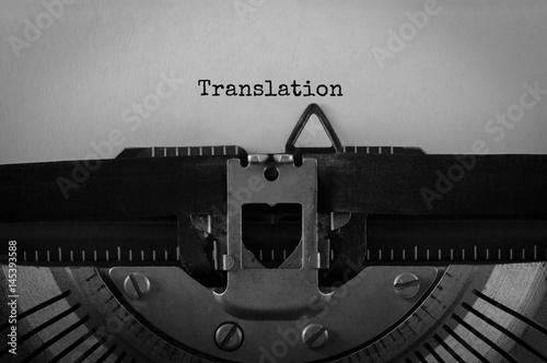 Fotografía  Text Translation typed on retro typewriter