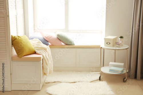 Obraz Interior of modern flat with comfortable place near window - fototapety do salonu