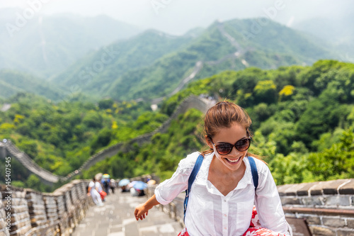 Fototapeta china travel at Great Wall. Tourist in Asia walking on famous Chinese tourist destination and attraction in Badaling north of Beijing. Woman traveler hiking great wall enjoying her summer vacation. obraz