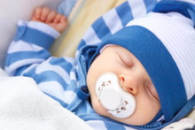 Newborn Baby With Pacifier Sle...