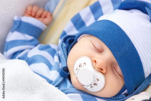 Fotomural Newborn baby with pacifier sleeping in baby pram
