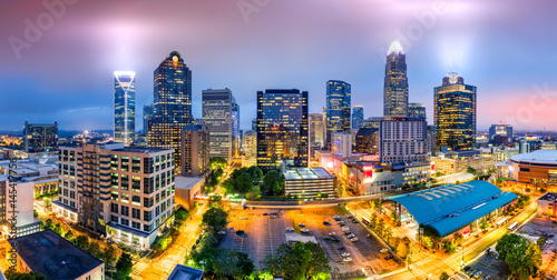 Garden Poster City building Aerial view of Charlotte, NC skyline on a foggy evening. Charlotte is the largest city in the state of North Carolina and the 17th-largest city in the United States