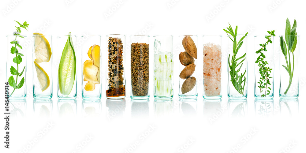 Fototapety, obrazy: Homemade skin care with natural ingredients aloe vera, lemon, cucumber, himalayan salt, peppermint, rosemary, almonds, cucumber, ginger and honey pollen isolated on white background.