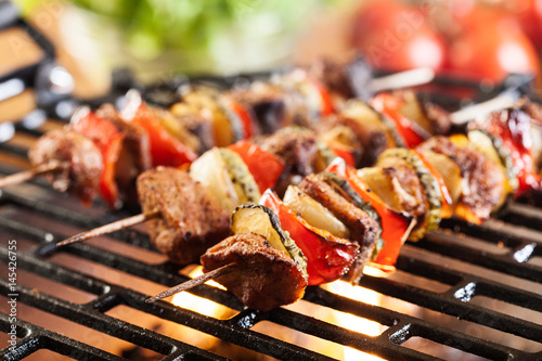 Tuinposter Grill / Barbecue Grilling shashlik on barbecue grill