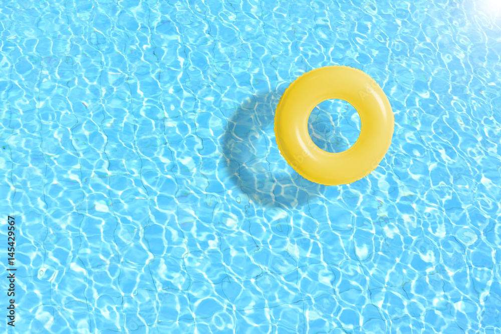 Fototapety, obrazy: yellow swimming pool ring float in blue water. concept color summer.